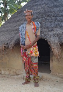 Oelekam cultural chief clad in a traditional ikat and bell-anklet